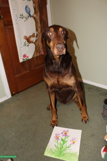 """i Hope He Will Like It,"" Says Scarlett The Doberman Of The Paw Print Artwork She Has Made"